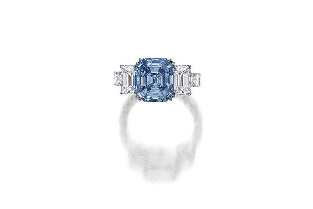 Lot 1784: Very Fine Fancy Intense Blue Diamond and Diamond Ring