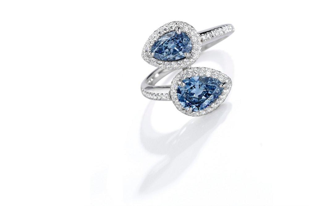 Lot 106: Exquisite Platinum, Fancy Vivid Blue Diamond and Diamond Ring, Estimate 700,000 — 1,000,000