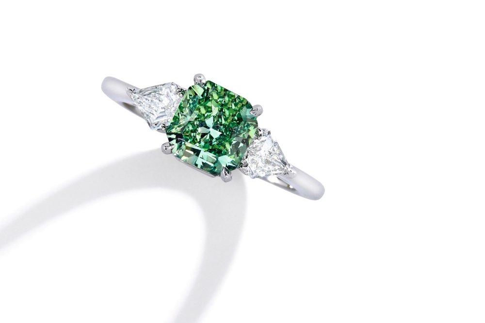 Lot 101: Rare Platinum, Fancy Vivid Green Diamond and Diamond Ring, Estimate 1,000,000 — 1,500,000
