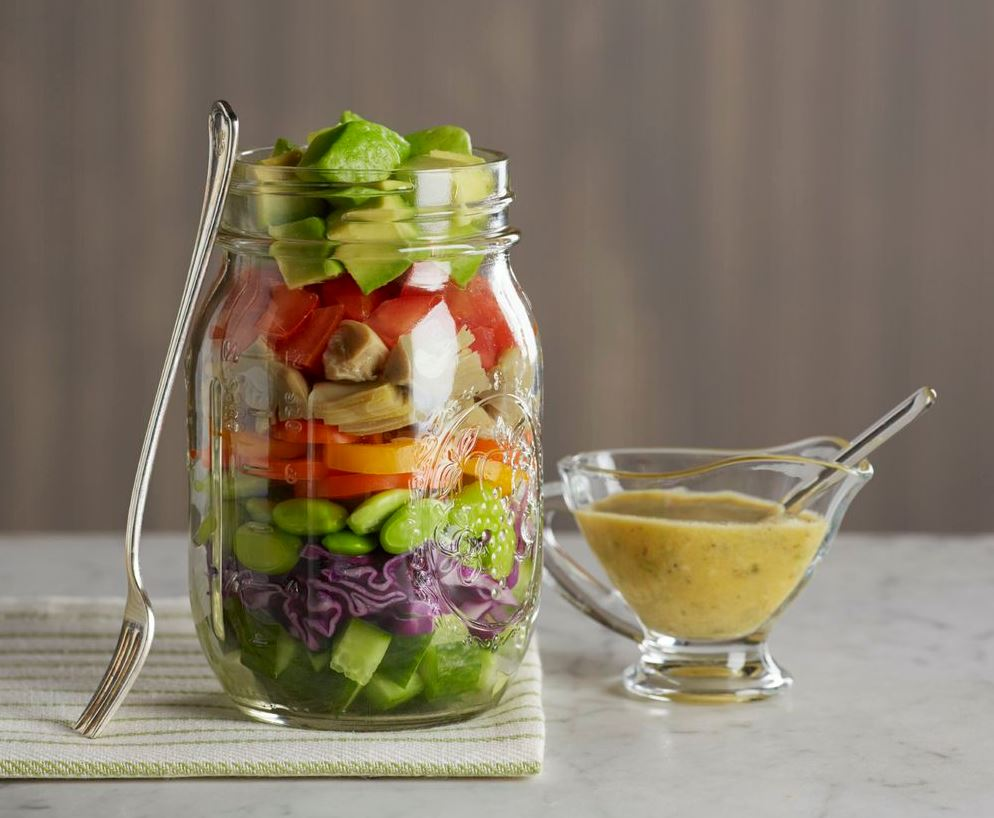 salad and dressing in mason jar