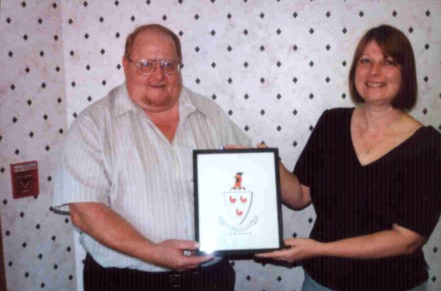 Lonnie Kiger with Lisa Tator, who donated Cockayne Family Crest to project