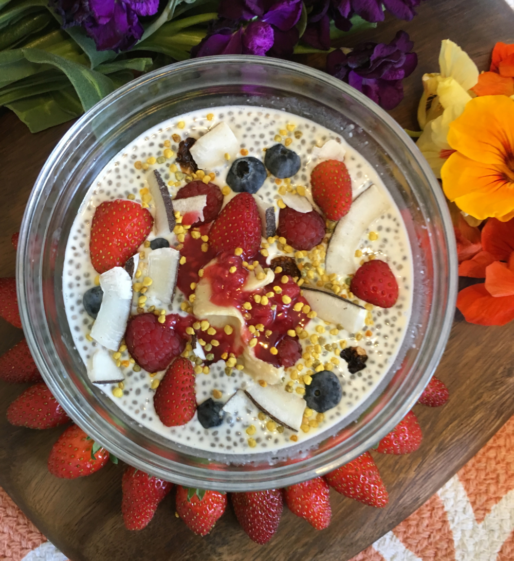 This beauty here is topped with: fresh blueberries, strawberries, raspberries, inca berries, coconut chips, cashew butter, cultured raspberry jam, bee pollen and lots and lots of LOVE!
