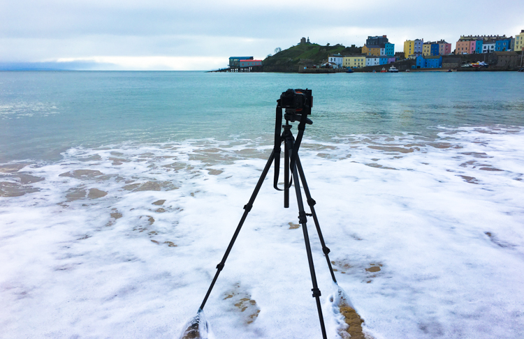 A flimsy tripod will be knocked over by wind, waves and weather. Taking your camera with it.