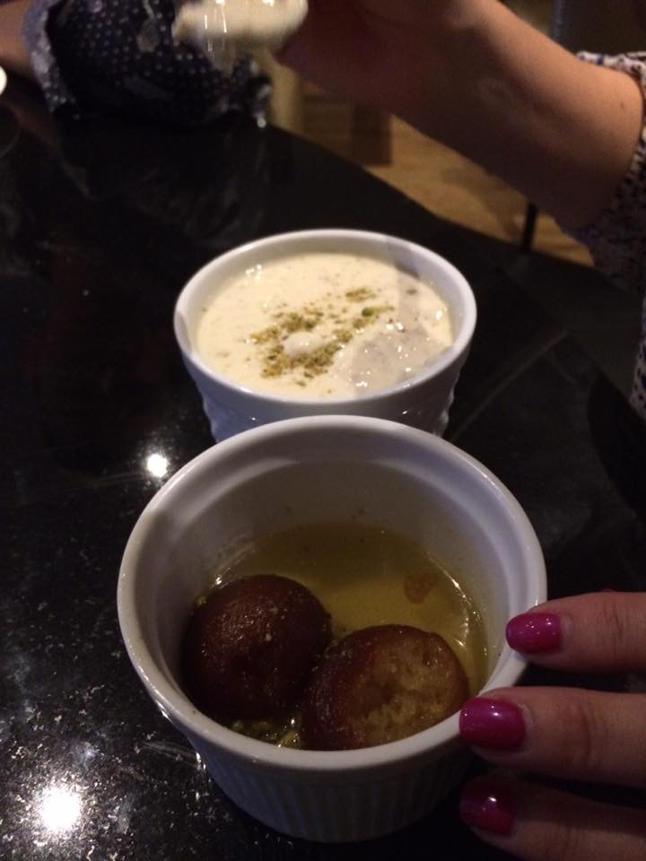 "After a marathon meal I still can't choose between my fave desserts so I had both! Gulab Jamun and Kheer. What can I tell you, I'm a piggy and as the great Oscar wilde said ""everything in moderation, including moderation""."