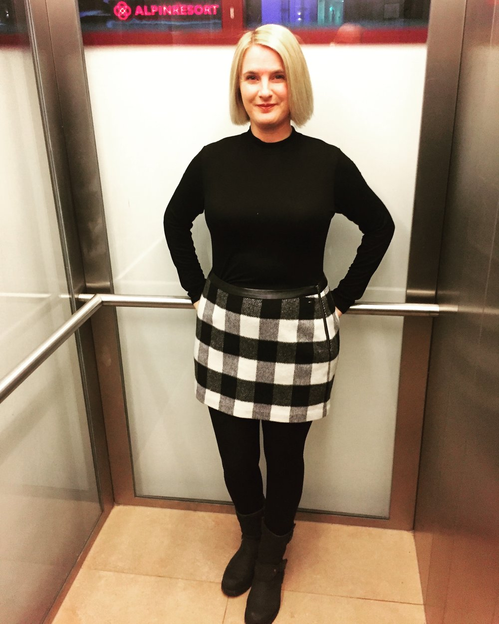 Top from Marks and Spencer, Skirt from Tommy Hilfiger, thick tights with a hole cut in from Tesco, Boots from Barbour.