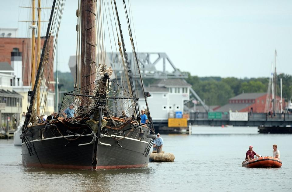 The schooner Amistad transits the Mystic River between the bridge after getting under way from Mystic Seaport en route Monday, August 29, 2016 to New London where it will dock through the Connecticut Maritime Heritage Festival September 9-11. Amistad will also make visits to New Haven and Bridgeport before returning to winter at Mystic Seaport. (Sean D. Elliot/The Day)