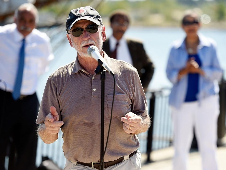 Len Miller, chairman of Discovering Amistad, addresses those gathered for a welcoming ceremony for the schooner Monday, August 29, 2016 on Amistad Pier on the New London Waterfront Park. (Sean D. Elliot/The Day)