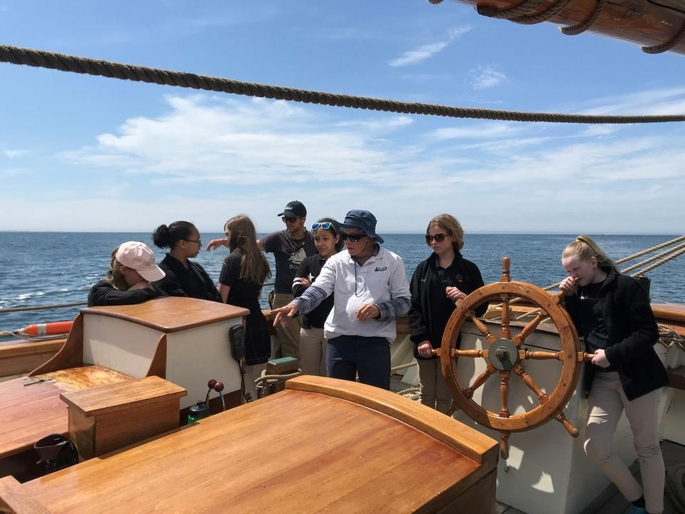 Amistad Capt. Rose Witte demonstrates equipment Thursday, May 31, 2018, for sixth-graders from New London's Bennie Dover Jackson Middle School during an outing on the Thames River. (David Collins/The Day)
