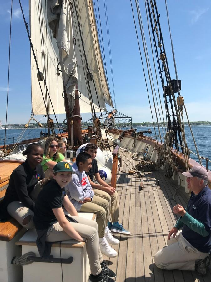 Amistad crew member Jason Hine leads a discussion Thursday, May 31, 2018, with students from New London's Bennie Dover Jackson Middle School during an outing on the Thames River. (David Collins/The Day)