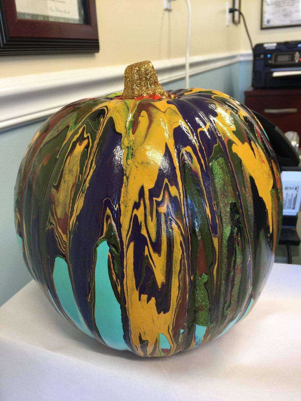 Seedlings' paint drip pumpkin.