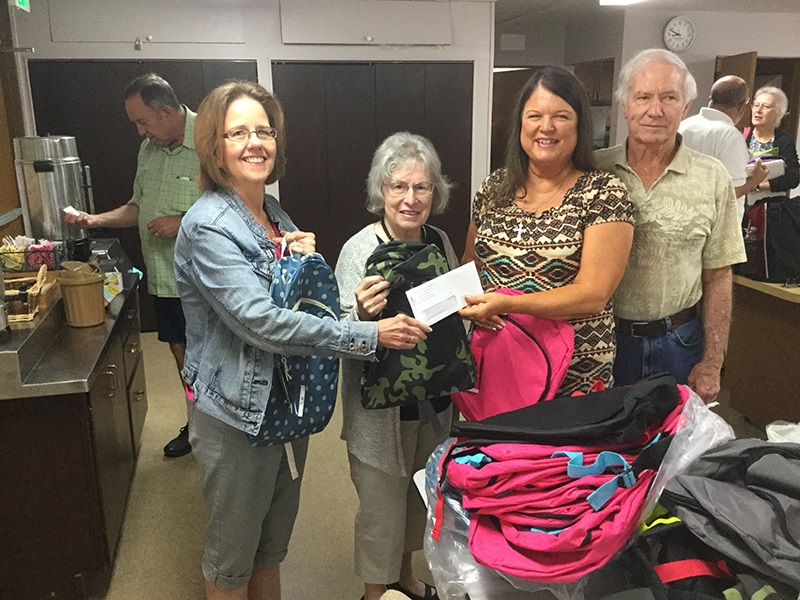 Hope House Olympic Peninsula Ministry Receiving Backpack Donation from Peace Bremerton WA