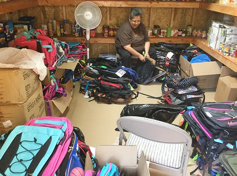 Hope House Volunteer Sorting Backpacks