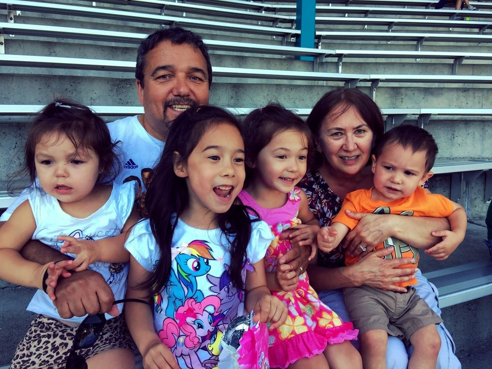 "Rick McCafferty (Inupiat/Cherokee), with his wife Jane, happy ""uppa"" to six grandchildren (2 grandsons not pictured)"
