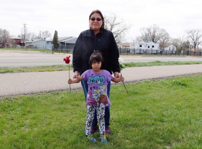Delberta Seminole Eagleman stands with grandchild, 4-year-old Shawnee, whom she raises along with 5 others on the Fort Peck Indian Reservation, in Wolf Point, Montana, April 28, 2016.  REUTERS/ELLEN WULFHORST