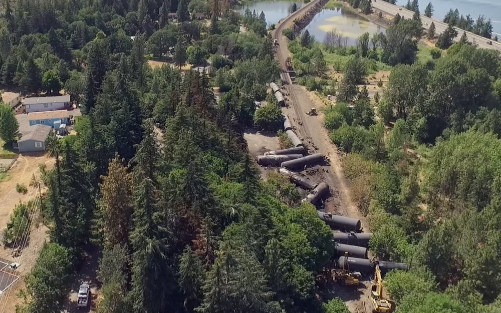 Oil Tankers derailed in Mosier, Oregon. Photo credit: Associated Press/Brent Foster