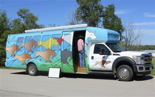 A bus that has been retrofitted with an art studio and space for a bank teller is crisscrossing South Dakota's Pine Ridge Indian Reservation. Photo credit: Regina Garcia Cano/AP Photo