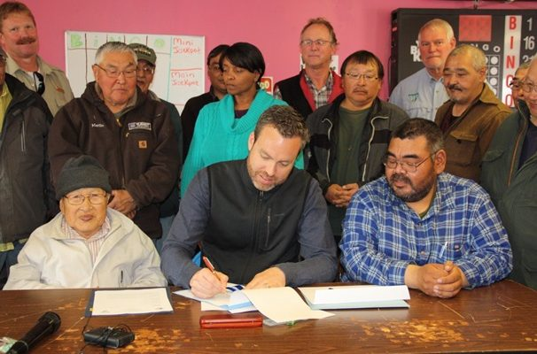 Neil Kornze of BLM signs final patent to transfer over 1 million acres of St. Lawrence Island to Native Corporations. Photo Credit: Bureau of Land Management