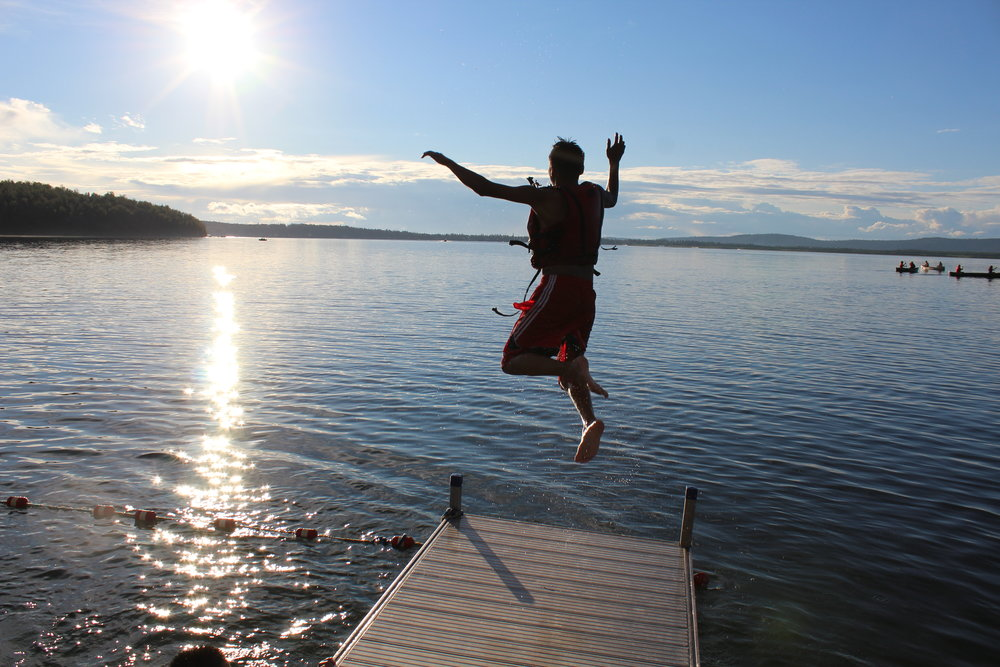 Jumping off the dock at Camp Bingle at Lutheran Indian Ministries Teen Camp Alaska