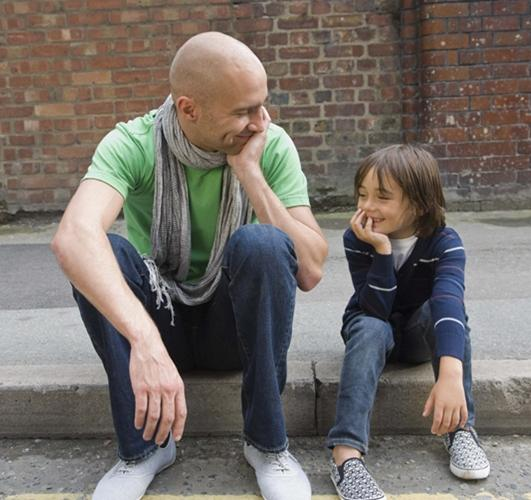 man and boy talking