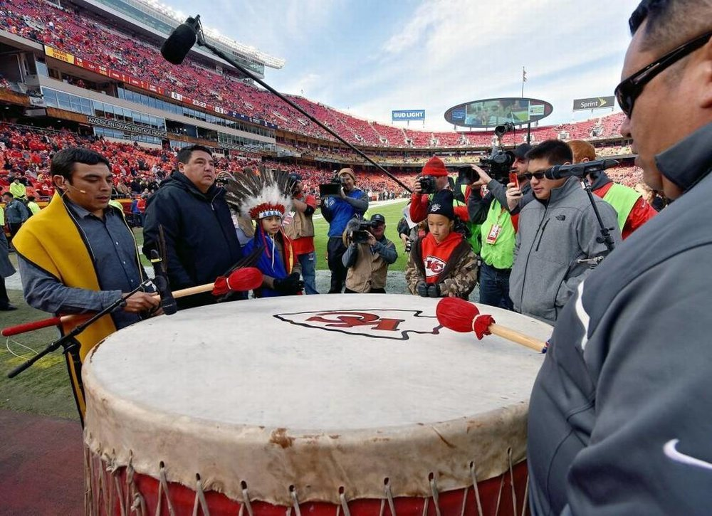 A group of Native Americans sing as they play the Chiefs' drum before a game at Arrowhead Stadium. John Sleezer/Kansas City Star