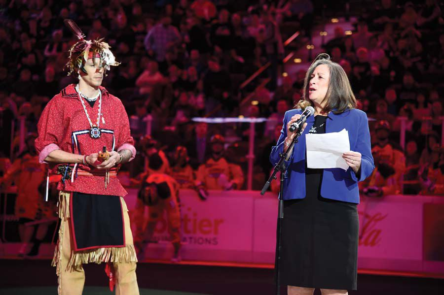 Dr. Lynn Malerba, Chief Many Hearts of the Mohegan tribe, right, during a pregame ceremony. Credit: New England Black Wolves