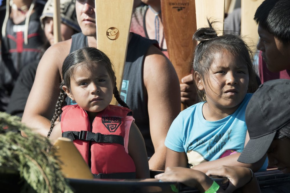 Two young native girls sitting patiently in the canoe. Photo by Gabrielle Colton