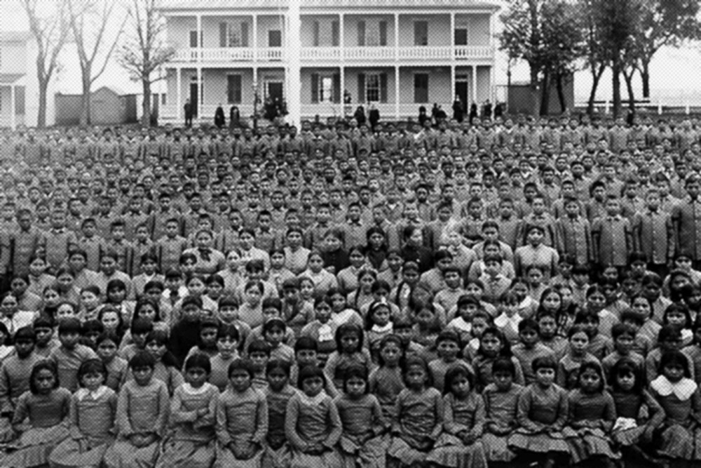Pupils at Carlisle Indian Industrial School, Pennsylvania (c. 1900) via  Wikimedia Commons