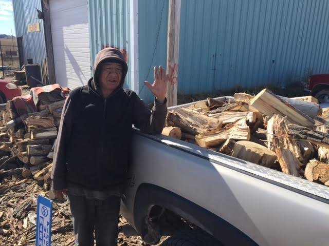 The nonprofit One Spirit hires five local residents to cut wood and deliver it to people in need on the reservation. The employees earn $100 to $150 per delivery. Photo credit: JERI BAKER/ONE SPIRIT