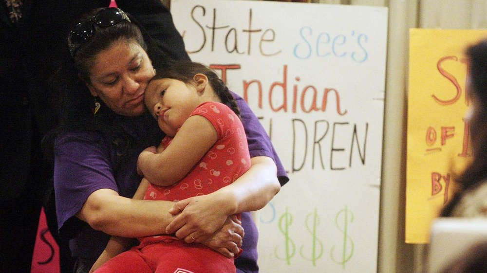 Madonna Pappan and her child in 2013. Pappan was is one of three Sioux mothers who sued South Dakota over its alleged violation of the Indian Child Welfare Act. AP Photo/Rapid City Journal, Kristina Barker lutheran indian ministries native news