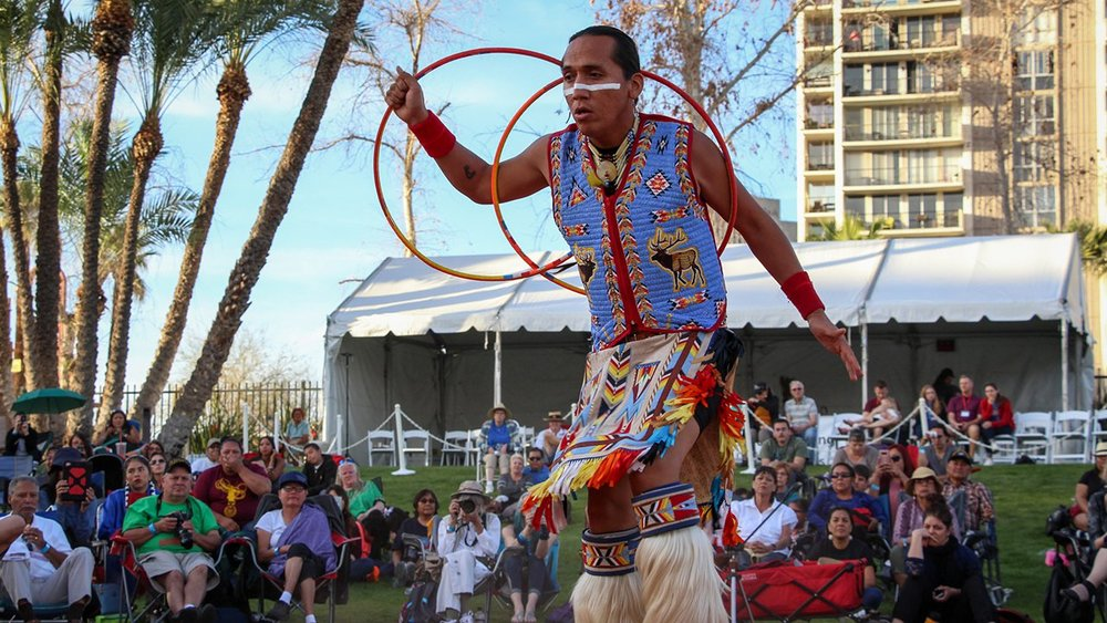Tony Duncan, a five-time world champion, dances in the first round of the World Championships of Hoop Dancing last month in Phoenix. (Photo by Lillian Donahue/Cronkite News) lutheran indian ministries native news