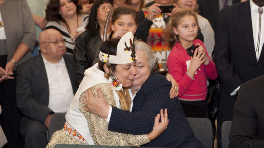 Natalie Proctor and Mervin Savoy, both of the Piscataway-Conoy Confederacy, embrace at a 2012 ceremony to celebrate Maryland's recognition of two tribes of Piscataway Indians.Photo By Jay Baker