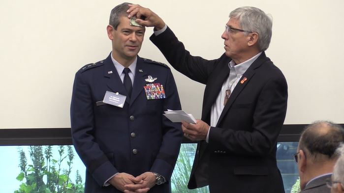 Air Force Lt. Gen. Ken Wilsbach accepts one of his new Alaskan native names during a ceremony held by the Alaskan Federation of Natives in Anchorage, Alaska, Aug. 21, 2018.