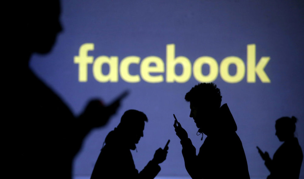 FILE PHOTO: Silhouettes of mobile users are seen next to a screen projection of Facebook logo in this picture illustration taken March 28, 2018. REUTERS/Dado Ruvic/Illustration/File photo - RC18854758D0 lutheran indian ministries native news