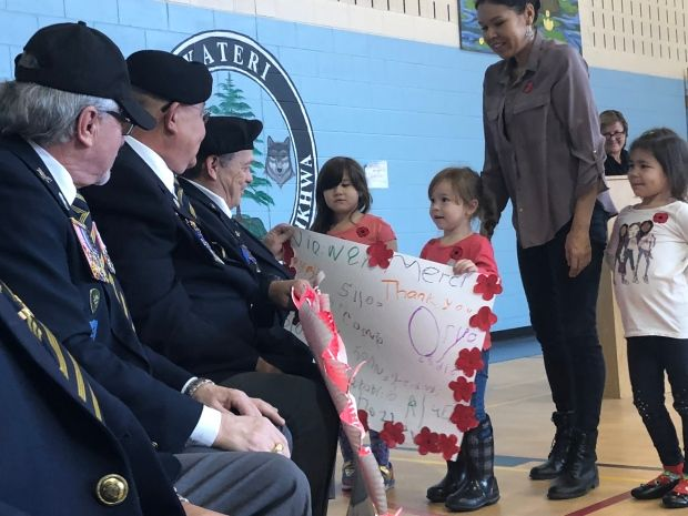Each grade at Kateri School presented homemade wreaths, artwork and poems to veterans in their community. (Jessica Deer/CBC)