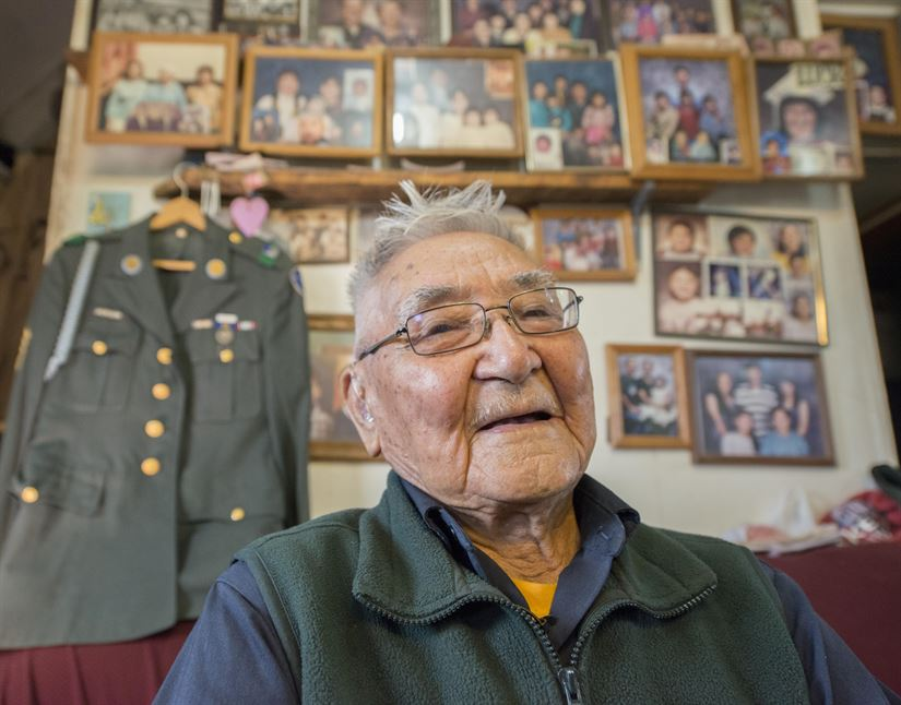 Retired Sgt. 1st Class Sam Jackson, who served in the Alaska Territorial Guard during World War II, poses for a photo inside his home in Kwethluk, Alaska, Sept. 23, 2017. Jackson and more than 6,300 native Alaskans voluntarily joined the territorial guard to defend their homeland against a potential invasion from Japanese forces.