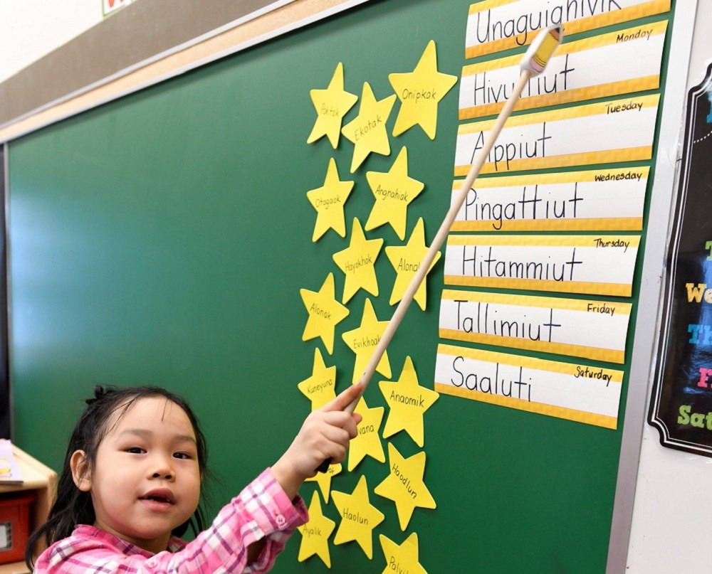 Here, a young Nunavut student learns the names of the week in Inuinnaqtun. (PHOTO COURTESY OF GN)