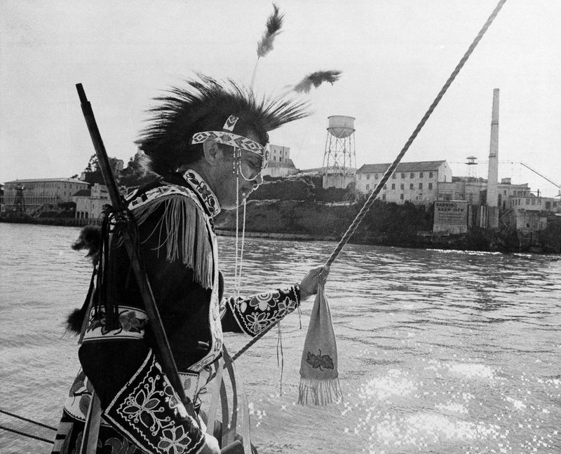 lutheran indian ministries native news - Adam Nordwall, 40, Chippewa, stands at the rail of the three-masted clipper Monte Cristo as it sails past Alcatraz Island in San Francisco Bay, Nov. 9, 1969. (Bill Beattie / AP)