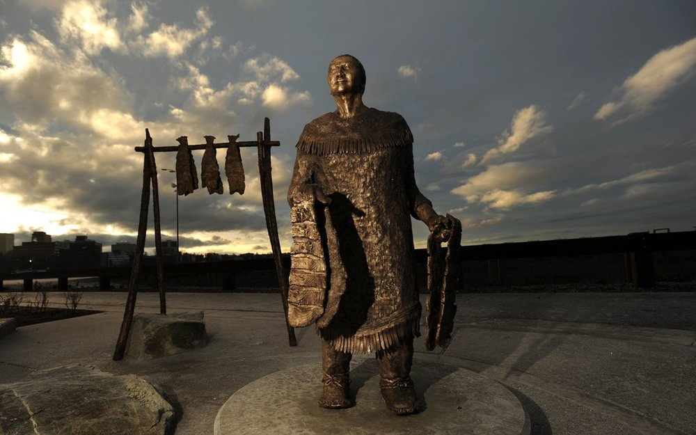lutheran indian ministries native news - Morning sunlight illuminates clouds behind the bronze sculpture of Grandma Olga Nikolai Ezi. (Bill Roth / ADN)