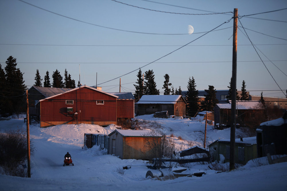 The moon hangs low in the sky over the remote Inupiat Eskimo village of Noorvik, Alaska, the first community in the U.S. counted for the 2010 census.  Carolyn Kaster/AP