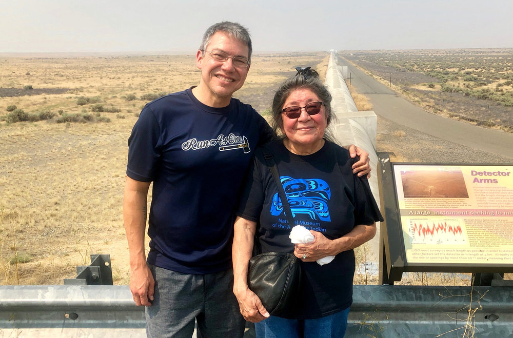 Scientist Corey Gray and his mother, Sharon Yellowfly, are pictured at one of the two massive detectors that make up the Laser Interferometer Gravitational-Wave Observatory. One facility, where Gray works, is in Washington state, and the other is in Louisiana. ( Courtesy of Russell Barber)