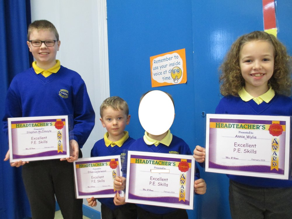 Stephen, Ethan and Annie received certificates for 'Excellent P.E. skills.