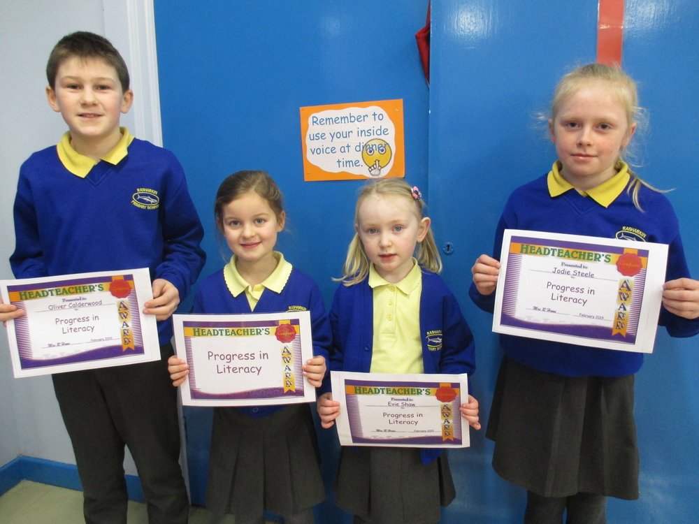 Oliver, Anna, Amelia and Jodie received certificates for ' Progress in Literacy'.