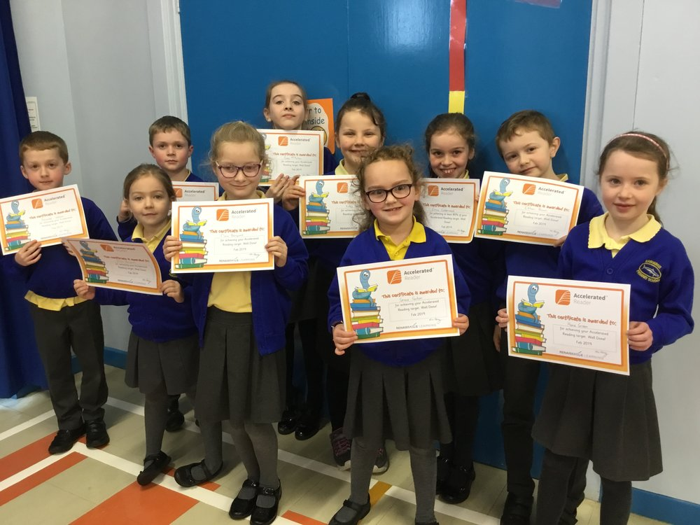 P4 children with their Accelerated Reading Certificates