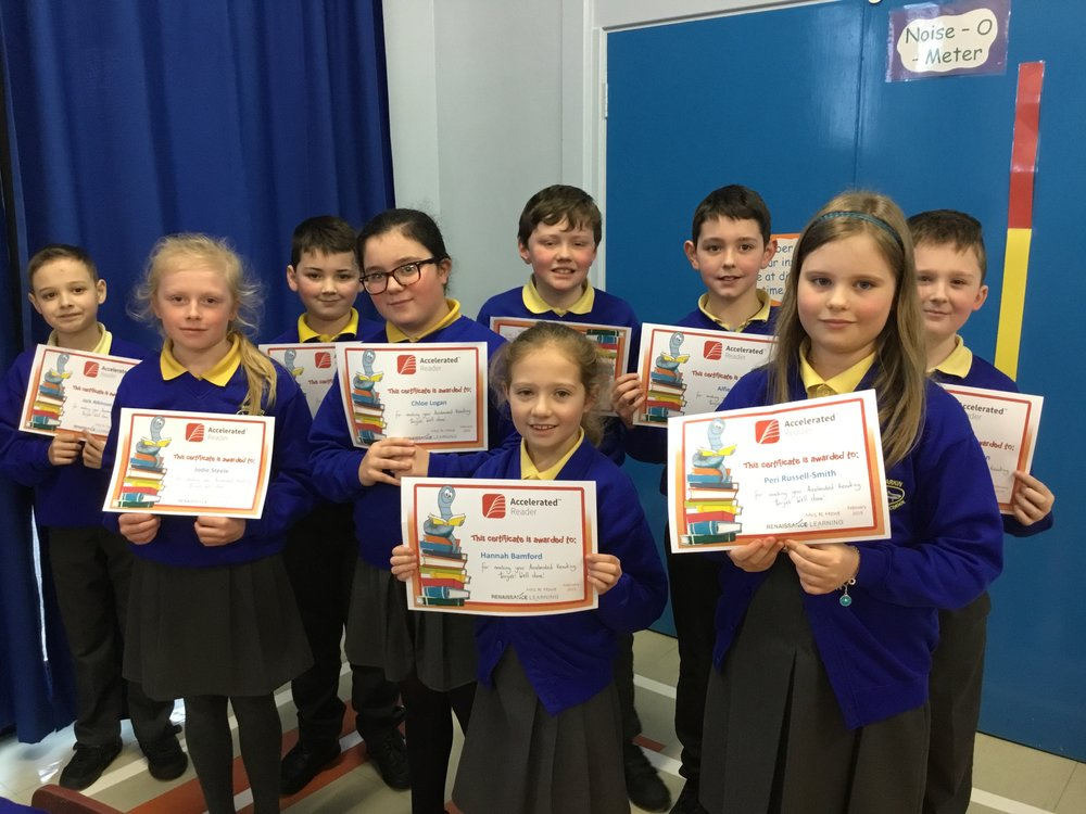 P6 children with their Accelerated Reading Certificates
