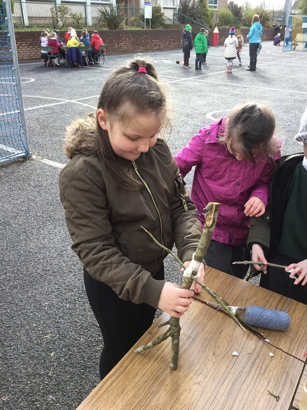 Kirsty working on her stick man.