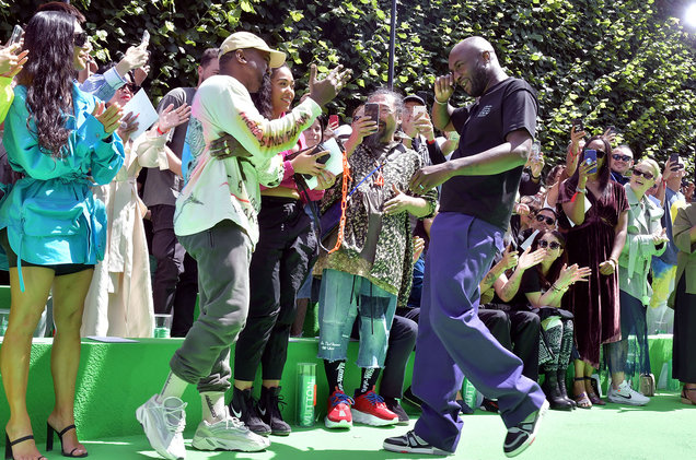 Virgil and Kanye sharing a tearful moment at the Louis Vuitton show; via   Billboard