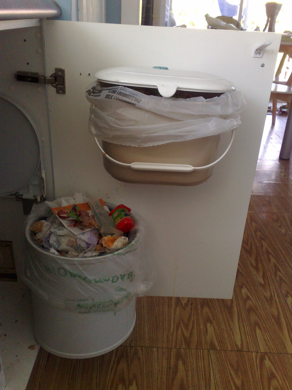 Kitchen Bin *above* Garbage by Nicolas Marchildon /CC BY