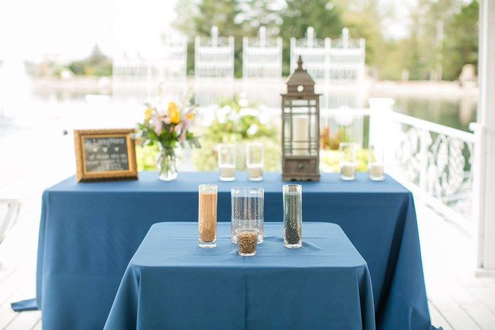 You can see the table in the background! A lantern, 5 candles & the flowers!