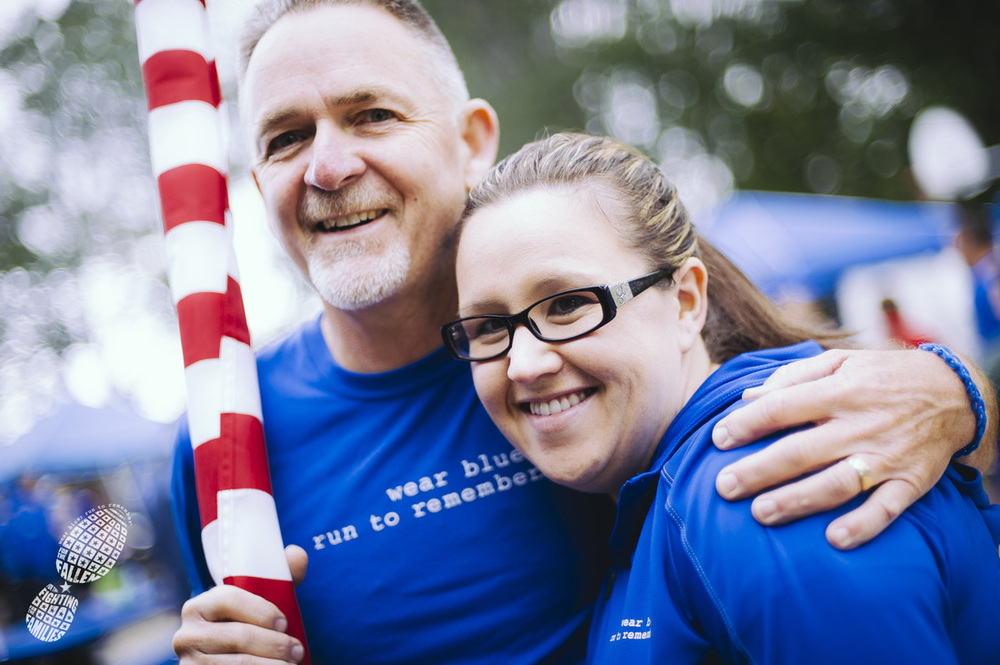 Teresa Maggart with wear blue community member and running partner Denny Bernardy at the JBLM Chapter 2014 Memorial Day Run. Photo courtesy Ingrid Barrentine/Grit City Photography.