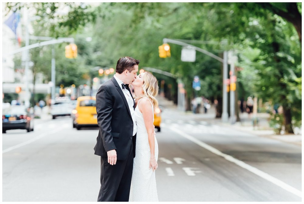 Couple celebrating anniversary in Central Park, yellow NYC cab